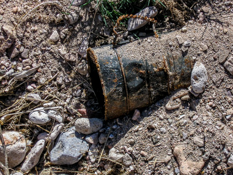 Buried tin coffee cup