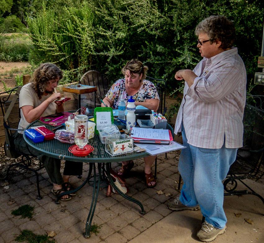 Work table with SABO volunteers