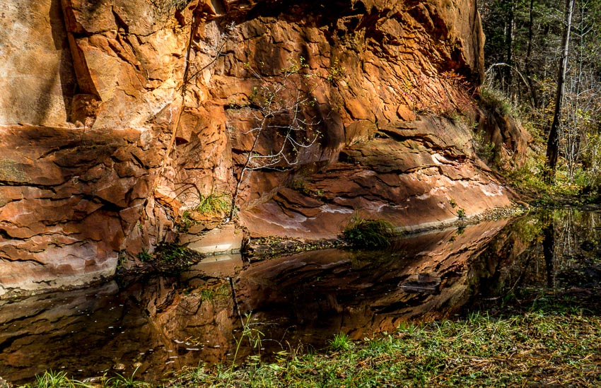reflection of beautiful red rock cliffs
