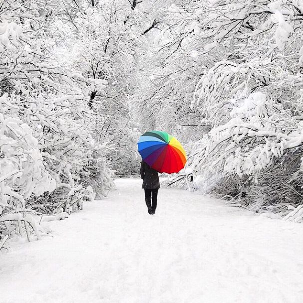 Surreal iPhone photo a colorful umbrella in a snow storm