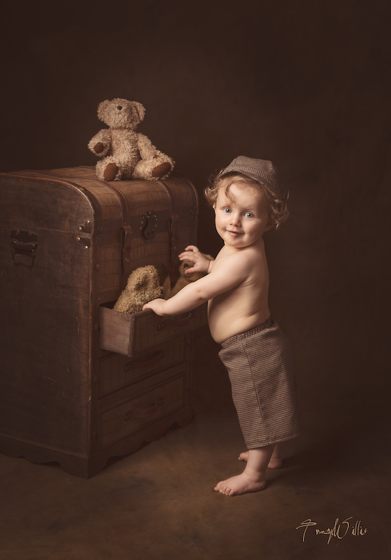 Soulful Boy with Toy Trunk