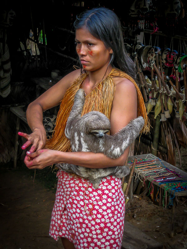 Native girl with pet sloth-Amazon