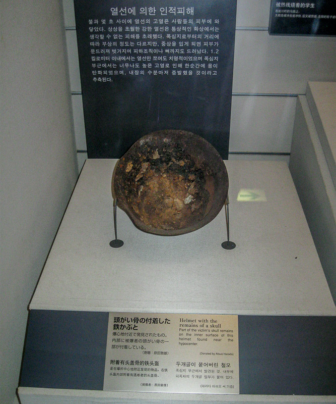Metal helmet with remains of a human skull, Nagasaki