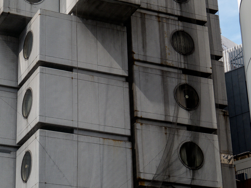 Closer look at the Nakagin Capsule Tower individual cubes with netting