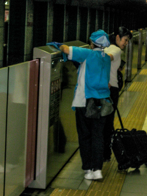 Subway worker cleaning