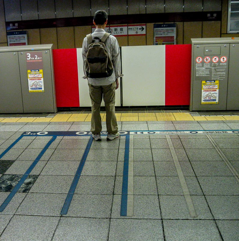 Man standing in line for train