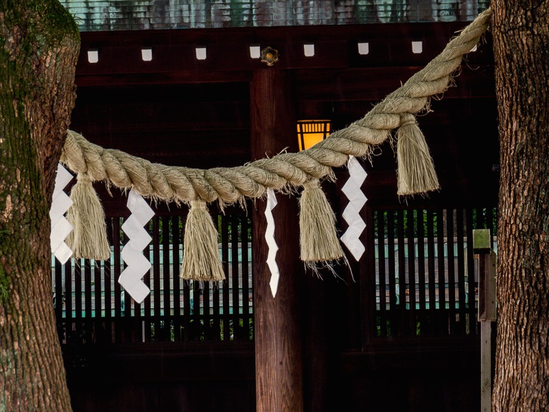 Closeup of rope and paper shapes used in purification rituals