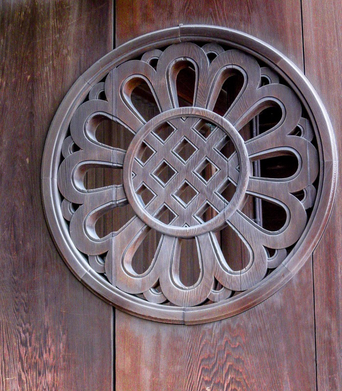 Carved wooden door medallion detail