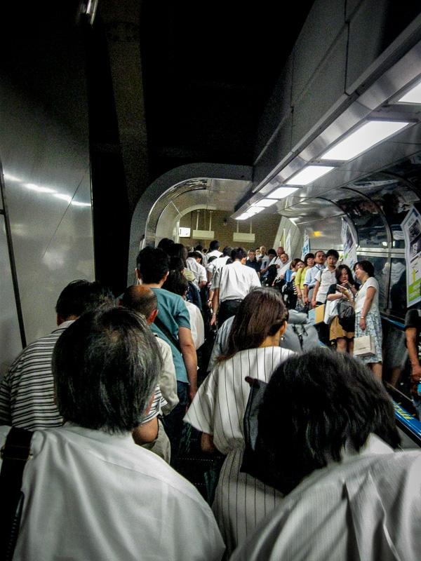 Crowded Train Station Escalator