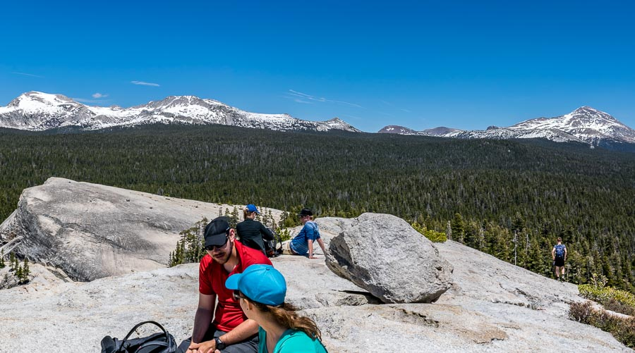 Hikers resting on top of Lembert Dome