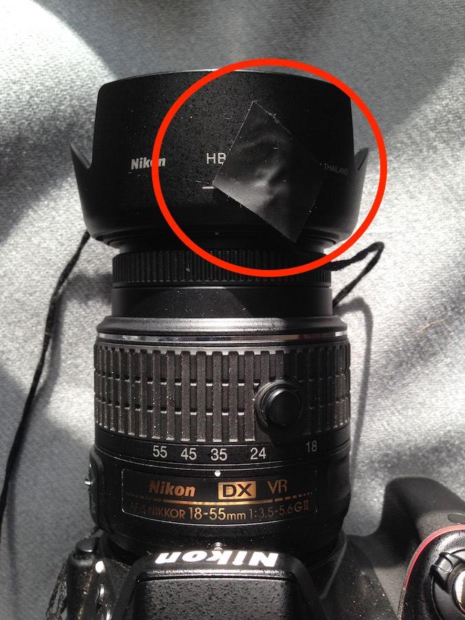 Nikon D3300 with tethered lens hood