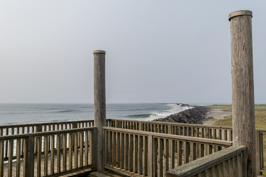 A viewing platfrom along a jetty or breakwall at Fort Stevens Park