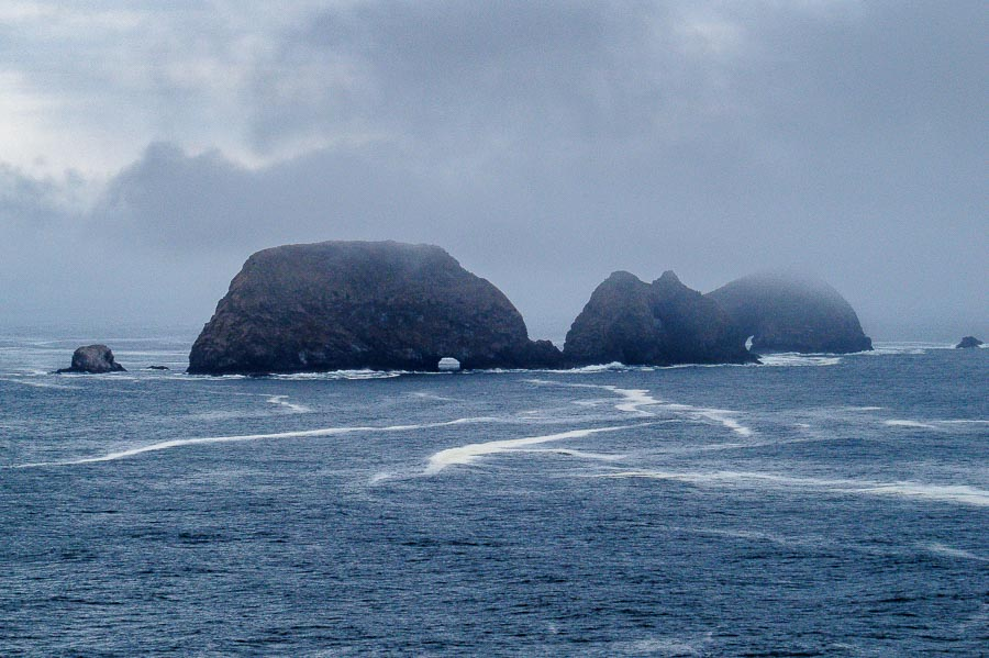 A closer view of the rock formations offshore