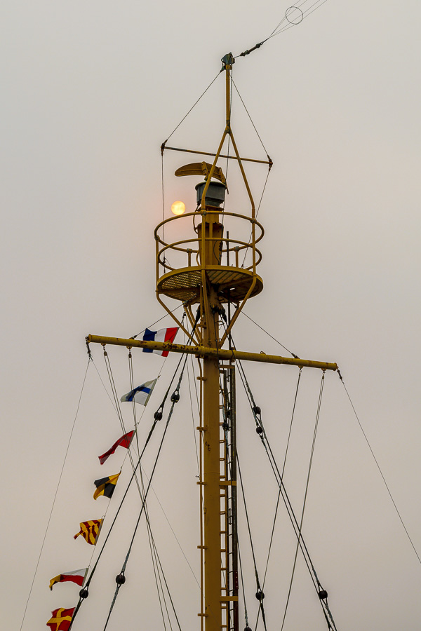 Waterfront ship's crows nest with sun