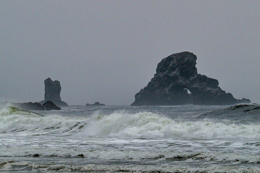 Dark, craggy rock formations just offshore