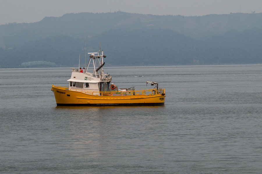 Boats busy studying and working along the Columbia River