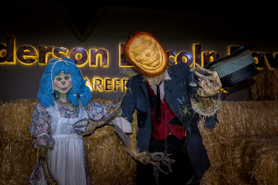 Halloween couple greets visitors on stage