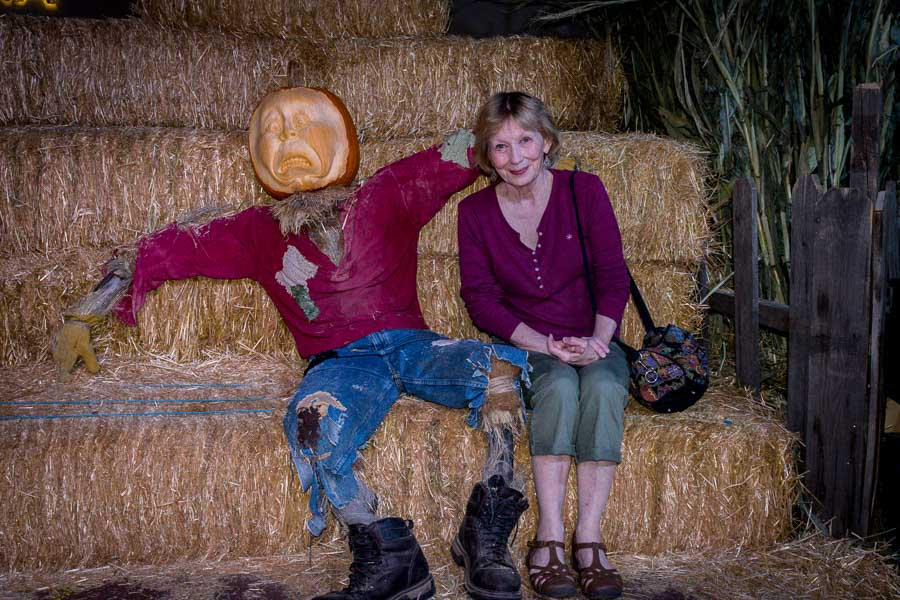 Have your picture taken atop hay bales with a pumpkin man