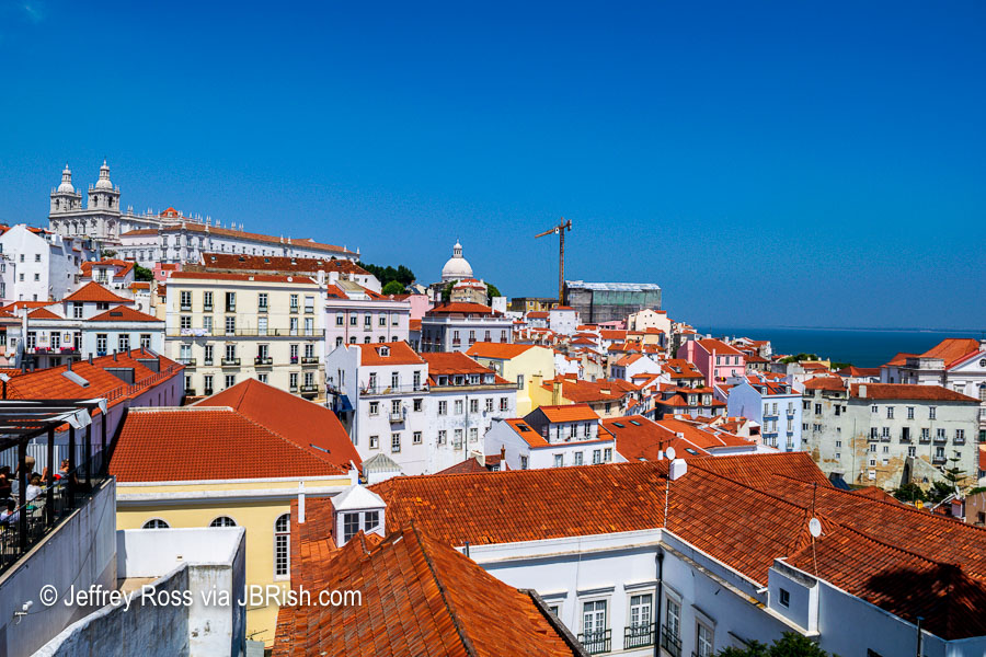 Landmark red roofs of Alfama seen from Miradouro das Portas do Sol