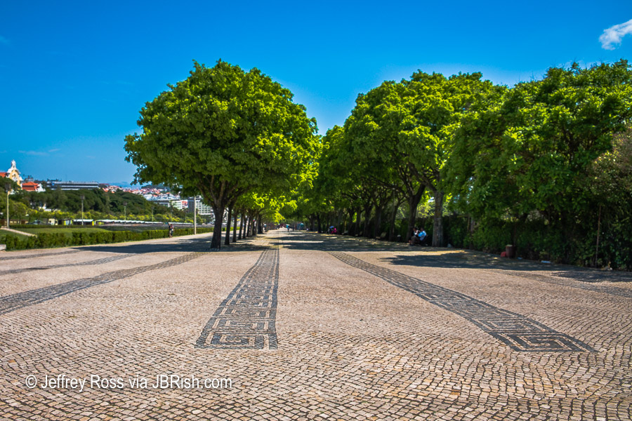 tree-lined, cobblestone walk of the Edward VII park