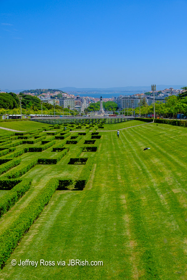 distant view of Alfama district and the Marques de Pombal statue from the Edward VII park