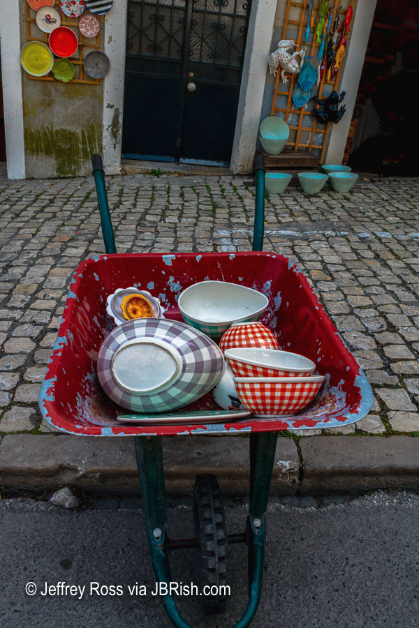 Wheelbarrow with dishes for sale