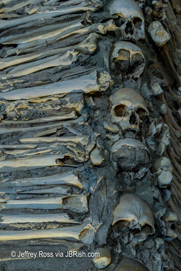 More skeletal remains in a support column