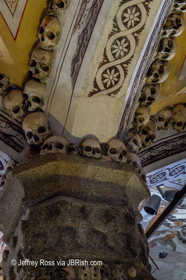 Skulls embedded in the arch of a support column