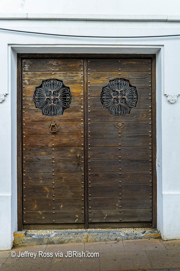 Aged wooden door with metal accents