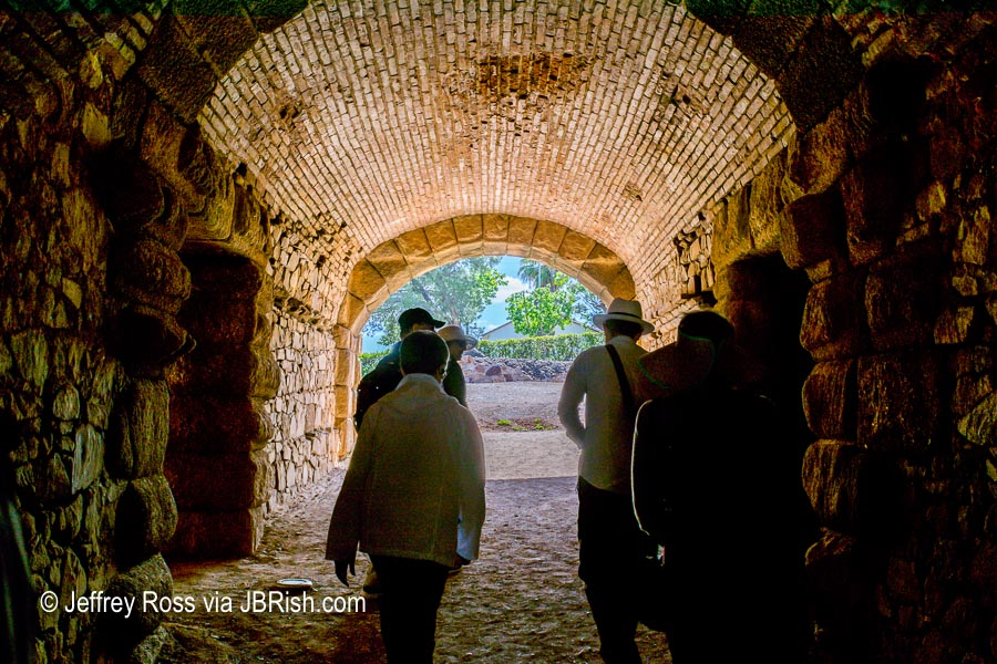 Tourists walking through Gladiator tunnel leading to the activity circle of the amphitheater