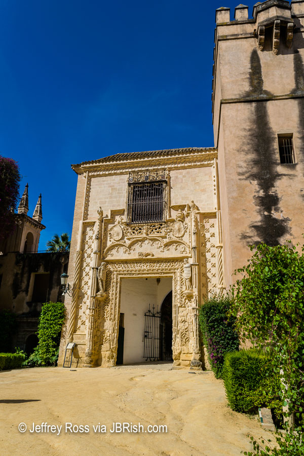 Intricately carved stonework of the exit portal at the Alcazar's garden