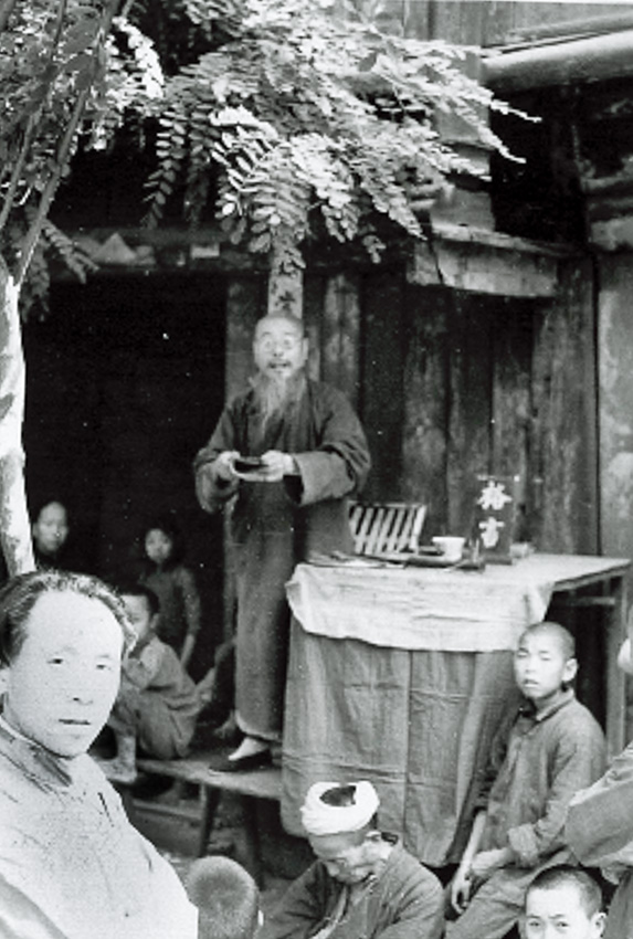 A village story teller takes a moment to pause for the picture.